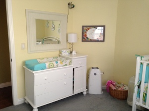 A view of the changing table/dresser with Layla decor and the Doxology print