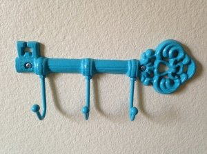 A cute key hanger that I found on Etsy, and which represents the secret key to the garden