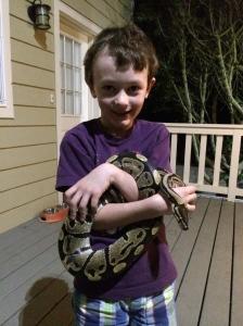 Benjamin holding a python. Eek!