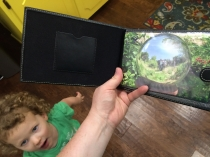 Mistaking a photo album for a Kindle Fire, and asking me to turn on the Mickey Mouse game!